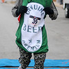 David Gregory, from Fairview, finishes the Junior Welfare League Warm Your Heart 5K in 25:24 in downtown Enid Saturday, Feb. 01, 2014. (Staff Photo by BONNIE VCULEK)