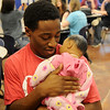 "Marshawn Mills holds a computer programmed baby during Kathy Gilliland's Family and Consumer Science class at Enid High School Thursday, Feb. 20, 2014. ""Baby Think it Over"" is just one of the projects that Gilliland uses in her classroom. Each student must care for one of the eight babies that Gilliland programs during an entire weekend. (Staff Photo by BONNIE VCULEK)"