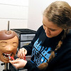 "Dental assistant student, Ashley McMullen, prepares ""Dexter"" for an x-ray during an open house Sunday at Autry Technology Center. (Staff Photo by BILLY HEFTON)"