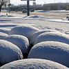 Snow on the landscaping outside Braums looks like giant scoops of ice cream Tuesday, Feb. 11, 2014. Another winter storm brought more than 4 inches of additional snow across much of northwest Oklahoma. (Staff Photo by BONNIE VCULEK)