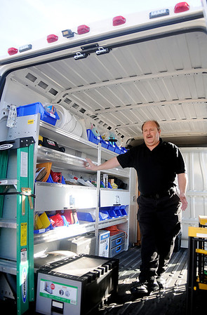 Tim Hess, Crime Scene Investigator for the Enid Police Department displays the interior of the new van purchased from Jacksons of Enid Friday, Feb. 21, 2014. (Staff Photo by BONNIE VCULEK)