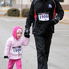 A father and daughter finish the Junior Welfare League Warm Your Heart one-mile fun run/walk in downtown Enid Saturday, Feb. 01, 2014. Proceeds from the event benefit the Oklahoma Heart Association. (Staff Photo by BONNIE VCULEK)