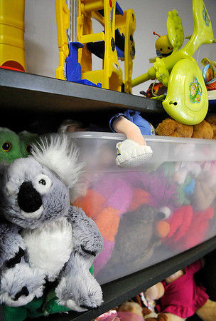 A koala bear sits on a shelf with other toys at the Airman's Attic at Vance Air Force Base. (Staff Photo by BILLY HEFTON)