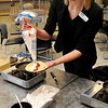 Culinary Arts instructor,  Jennifer O'Brien, fills a crepe during an open house Sunday at Autry Technology Center. (Staff Photo by BILLY HEFTON)