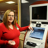 Stephanie Granger, manager of patient access services at Integris Bass Baptist Health Center, explains how to use the outpatient kiosk for pre-registration surgery and radiology clients. The use of the new kiosk has decreased wait time for outpatient procedures at the hospital. (Staff Photo by BONNIE VCULEK)