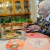 Helen Klein glances through the valentines that five generations of her family have received since 1890 to date Thursday, Feb. 13, 2014. (Staff Photo by BONNIE VCULEK)