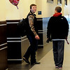 "An Enid High School student walks the University Center hallway with a ""Happy Valentine's Day"" balloon tied to his backpack Friday, Feb. 14, 2014. (Staff Photo by BONNIE VCULEK)"