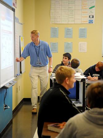 Craig Liddell (far left) instructs a biology class at Enid Public Schools' University Center Thursday, Feb. 20, 2014. (Staff Photo by BONNIE VCULEK)