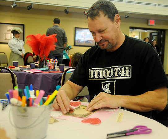 Wayne Sudol creates a Victorian valentine for his wife during craft day at the Cherokee Strip Regional Heritage Center Saturday, Feb. 8, 2014. (Staff Photo by BONNIE VCULEK)