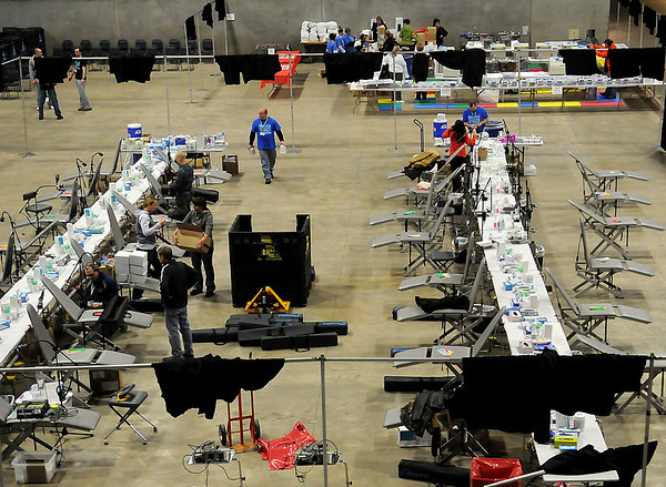 Volunteers set up for the Oklahoma Mission of Mercy at the Chisholm Trail Expo Center Thursday, Feb. 6, 2014. The two-day event offers free dental care to those in need beginning early Friday morning. Due to frigid outdoor temperatures, prospective patients may begin arriving at the Pavilion at 5 p.m. Thursday evening. The American Red Cross will provide food and beverages Friday and Saturday. (Staff Photo by BONNIE VCULEK)