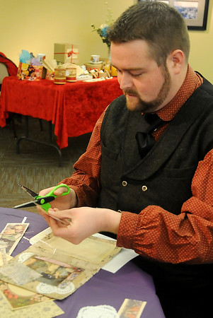 Cody Jolliff, education director at the Cherokee Strip Regional Heritage Center, creates a hand-made Victorian valentine for a loved one Saturday, Feb. 8, 2014. (Staff Photo by BONNIE VCULEK)