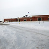 A heavy equipment operator has been keeping Prairieview Elementary School driveways clear of snow since parents had difficulty dropping their children off for classes early Wednesday, Feb. 5, 2014. (Staff Photo by BONNIE VCULEK)