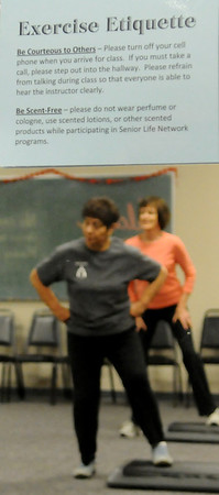 Exercise Etiquette is posted on a mirror at the Senior Life Network as individuals participate in the senior fitness class at Oakwood Mall Friday, Feb. 14, 2014. (Staff Photo by BONNIE VCULEK)