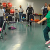 Dorothy Weidner leads a class of the Silver Sneakers in a work out during a senior fitness class at the Denny Price Family YMCA. (Staff Photo by BILLY HEFTON)