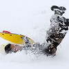 Juan Arriaga tumbles down a snow-covered hill as he sleds in Enid, Okla. Tuesday, Fed. 04, 2014. Schools were cancelled after a winter storm brought sleet and 4-8 inches of snow across northwest Oklahoma. (Staff Photo by BONNIE VCULEK)