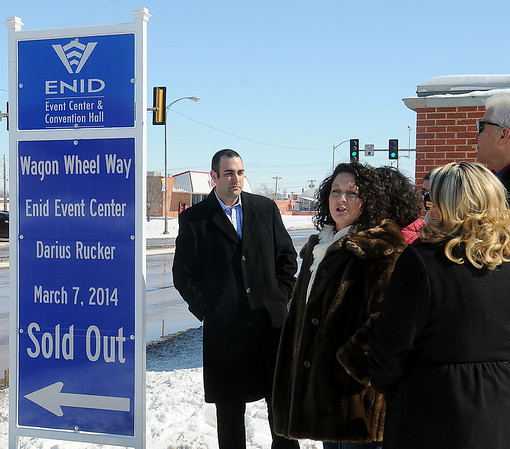 "Keller Taylor, general manager of the Enid Event Center and Convention Hall, stands next to the new street sign that officially renames Independence Avenue (between Owen K. Garriott and Maine) ""Wagon Wheel Way"" Tuesday, Feb. 11, 2014, in honor of the sold-out Darius Rucker concert on March 7, 2014. (Staff Photo by BONNIE VCULEK)"