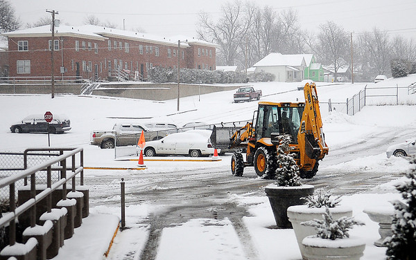 A heavy equipment operator clears snow from the main parking lot at St. Mary's Regional Medical Center Tuesday, Feb. 4, 2014. (Staff Photo by BONNIE VCULEK)