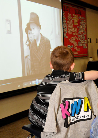 Prairie View fourth grader, Collin Skalla, watches a screening of a video produced by the class that will be entered into a national competition. (Staff Photo by BILLY HEFTON)