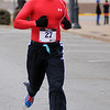 Philip Crum finishes the Junior Welfare League Warm Your Heart 5K  in 20:20 in downtown Enid Saturday, Feb. 01, 2014. Crum placed first in the Male 20-29 age group and second overall male runner. (Staff Photo by BONNIE VCULEK)