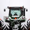 A massive John Deere tractor is obscured by heavy snowfall in Enid Saturday, Feb. 28, 2015. (Staff Photo by BONNIE VCULEK)