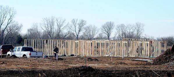 Framing begins on a new home in the Tara Estates on N. Oakwood Road Thursday, Feb. 5, 2015. (Staff Photo by BONNIE VCULEK)