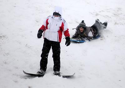 Teens brave the N. Van Buren overpass slopes as heavy snow falls in Enid Saturday, Feb. 28, 2015. (Staff Photo by BONNIE VCULEK)