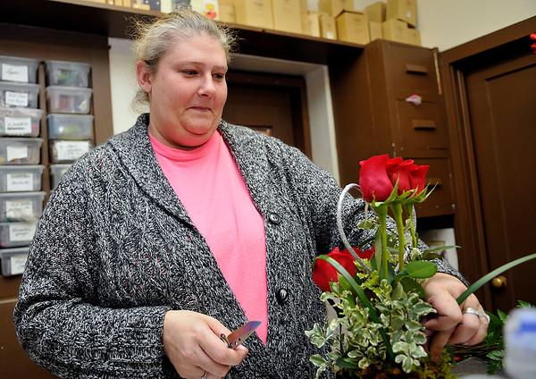 Angel Replogleworks on a floral arrangement at Huffman Floral Saturday February 13, 2016. (Billy Hefton / Enid News & Eagle)