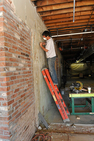 Steven Thomas works on a wall at Leonardo's Children's Museum Feb. 25, 2016 during the ongoing remodeling. (Billy Hefton / Enid News & Eagle)