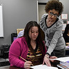 Lincoln Academy teacher, Jana Davis, works with Kim Trinidad Wednesday February 15, 2017. (Billy Hefton / Enid News & Eagle)