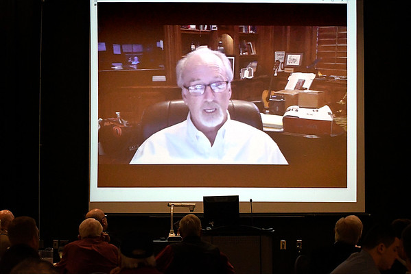Dr. David Vanhooser, candidate for Enid city council ward 6, addresses the Noon AMBUCS via video Friday February 10, 2017 at the NOC Gantz Center. (Billy Hefton / Enid News & Eagle)