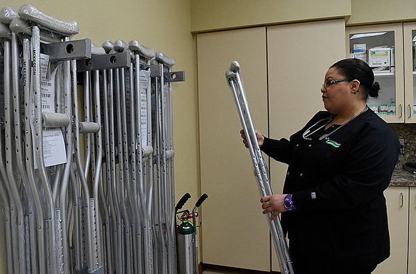 Summer Cole, LPN looks at a set of cruthches at Express Wellness February 16, 2017. (Billy Hefton / Enid News & Eagle)