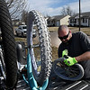 Jason Gragg works to put new inner tubes in bicycles for his kids Friday February 17, 2017. (Billy Hefton / Enid News & Eagle)