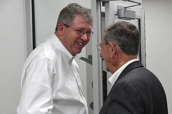 Congressman Frank Lucas visits with Enid Mayor Bill Shewey following a closed to the public meeting with Enid leaders on the subject of immagration reform Thursday February 23, 2017 at Autry Technology Center. (Billy Hefton / Enid News & Eagle)