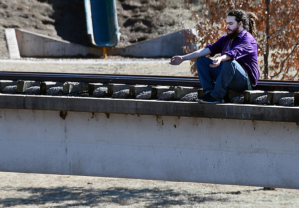 Jacob McNew meditates while sitting on the railroad bridge at Meadowlake Park Tuesday February 21, 2017. (Billy Hefton / Enid News & Eagle)