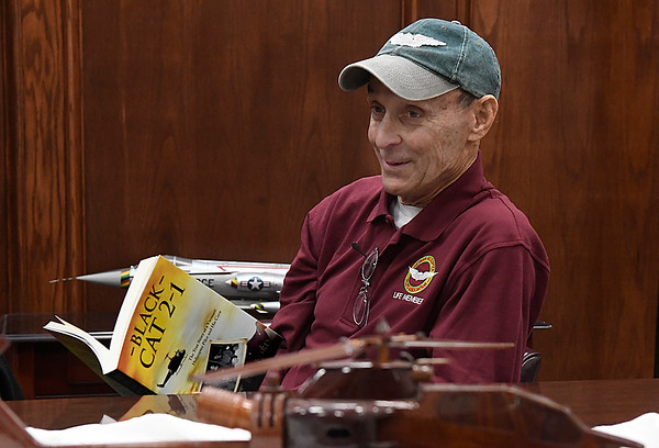 Bob Ford holds a copy of his book, Black Cat 2-1, during an interview Wednesday February 7, 2018 at the M.L. Becker Educational Center at Woodring Vetetrans Park. (Billy Hefton / Enid News & Eagle)