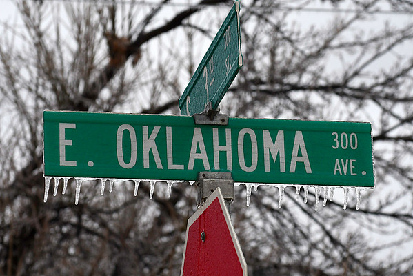 Icicles hang from a street sign after freezing rain moved across northwest Oklahoma Tuesday February 20, 2018. (Billy Hefton / Enid News & Eagle)