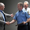 Enid firefighter, Harley Long, to congratulated by Dr. Richard DeVaughn and Fire Chief Joe Jackson after being named Enid Firefighter of the Year during a ceremony Monday Febraury 5, 2018 at the Enid Fire Department. (Billy Hefton / Enid News & Eagle)