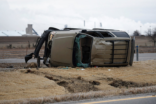 A suv rest on its side in th emedian of US 412 east of Enid Tuesday February 20, 2018. (Billy Hefton / Enid News & Eagle)