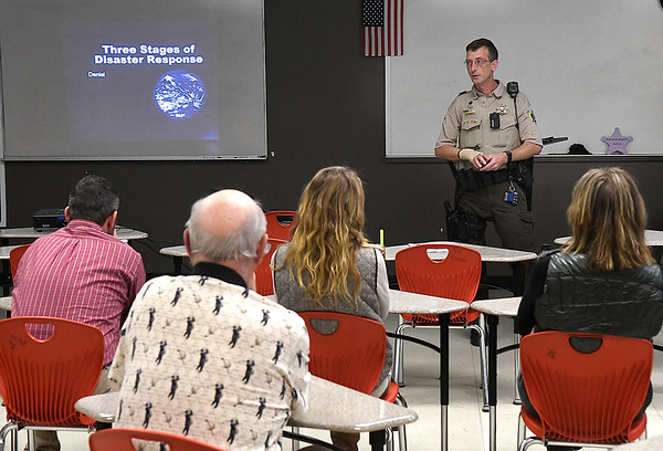 Garfield county deputy, Lloyd Cross, gives an A.D.D. (Avoid, Deny, Defend) class to Kremlin-Hillsdale teachers Wednesday February 13, 2019 at Kremlin-Hillsdale High School. A.D.D. is an easy-to-remember three step plan for survival in the event of an active shooter event or other public acts of violence. (Billy Hefton / Enid News & Eagle)