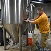 Keith Griesel, owner of Expendinture Brewery in Okarche, cleans equipment Wednesday February 5, 2020. The brewery is scheduled to open February 15. (Billy Hefton / Enid News & Eagle)