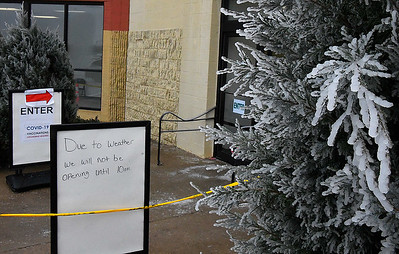 Ice clings to a tree at the entrance of the COVID-19 vaccination clinic Monday, February 8, 2021. (Billy Hefton / Enid News & Eagle)