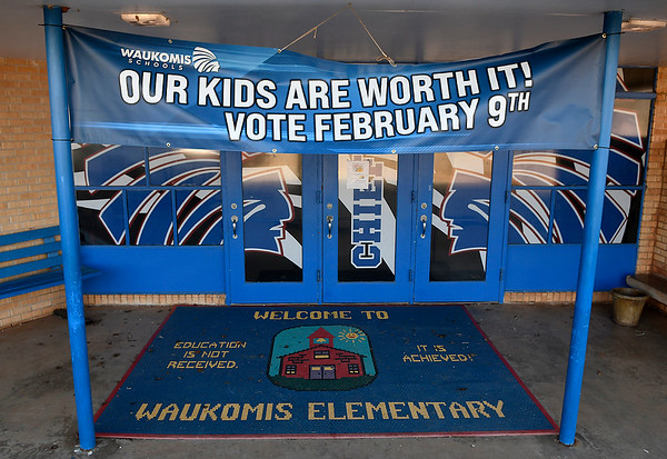 Banner hanging over the entrance of Waukomis Elementary supporting the school bond election February 9. (Billy Hefton / Enid News & Eagle)