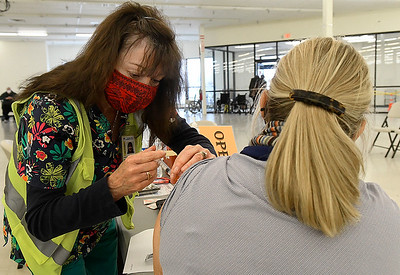 Vickie Bright, a nurse with the Department of Health, gives a vaccine shot to a patient Monday, February 8, 2021 at Oakwood Mall. (Billy Hefton / Enid News & Eagle)