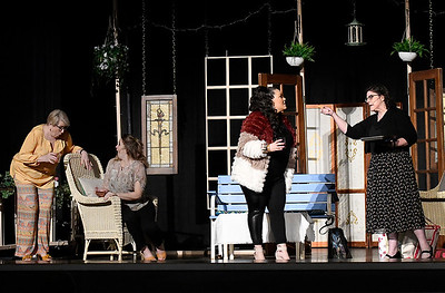"""(left to right) Janet Jones, Katie Pearce, Mary Porter Pickering and April Swinnea-Ogg rehearse a scene of Gaslight Theater's production of """"Savannah Sipping Socity"""" Thursday, February 11, 2021 at the Stride Bank Center. (Billy Hefton / Enid News & Eagle)"""