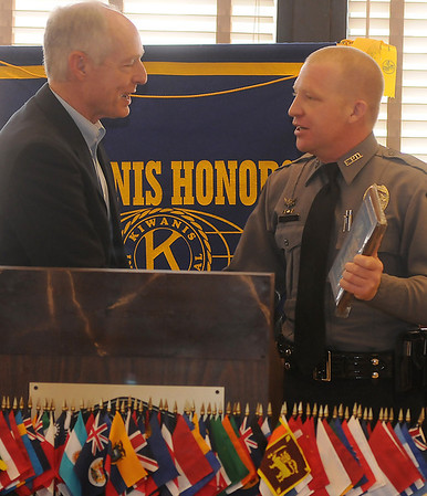 The Honorable Judge Perry congratulates Randall Wilson, Enid Police Department Officer of the Year, during the Enid Kiwanis Club luncheon at Best Western's Dutch Pantry Wednesday, Jan. 30, 2013. (Staff Photo by BONNIE VCULEK)