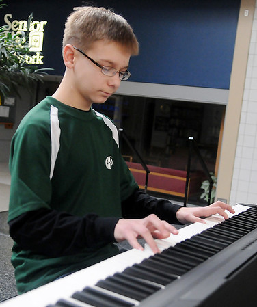 Will Church, from the Fairview 4-H Club, plays a Charlie Brown medley Saturday during the Garfield County 4-H Day at Oakwood Mall. (Staff Photo by BONNIE VCULEK)
