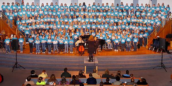Students from northwest Oklahoma perform during the 2013 Circle the State with Song Region B Choral Festival Tuesday at Emmanuel Baptist Church. (Staff Photo by BILLY HEFTON)