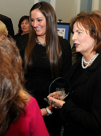 Martie Oyler (right) and her daughter, Grace Enmeier, visit with guests after Oyler was named the Enid News & Eagle 2012 Pillar of the Plains award winner Thursday during a reception at the Convention Hall Junior Ballroom. (Staff Photo by BONNIE VCULEK)