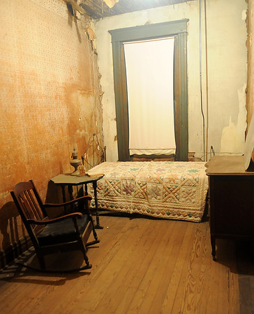Furnishings fill the former hotel room where David E. George committed suicide 110 years ago. The famous site, located on the top floor of Garfield Furniture at 123 S. Grand Avenue, is part of the Enid historical tour. (Staff Photo by BONNIE VCULEK)