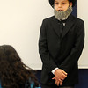 Lane Doffer brings history to life as her portrays Abraham Lincoln during Desiree Highberger's fifth-grade re-enactments Thursday at Monroe Elementary School. (Staff Photo by BONNIE VCULEK)